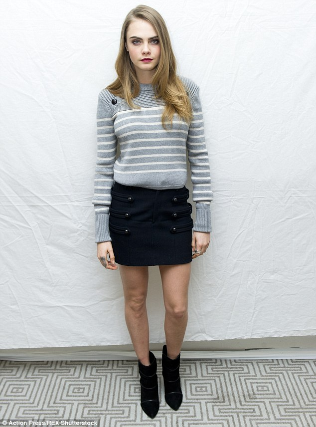 Legs eleven! Cara Delevingne showed off why she's also a model at the press conference for Paper Towns in Hollywood on Thursday