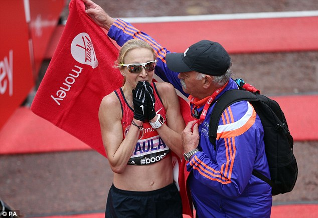 Paula Radcliffe breaks down at the end of the London Marathon on Sunday, her final career race