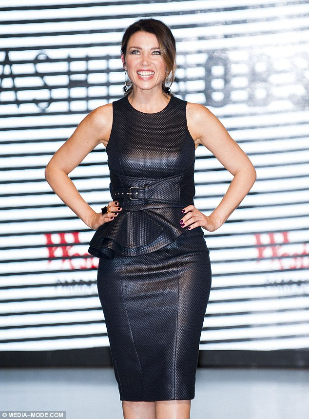 Sexy mumma! Themother-of-one appeared at Westfield Sydney on Thursday wearing a faux leather little black dress with belt and ruffle detailing