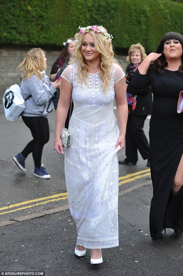 Pretty as a flower: Kirsty-Leigh Porter wore a garland and an embroidered white dress