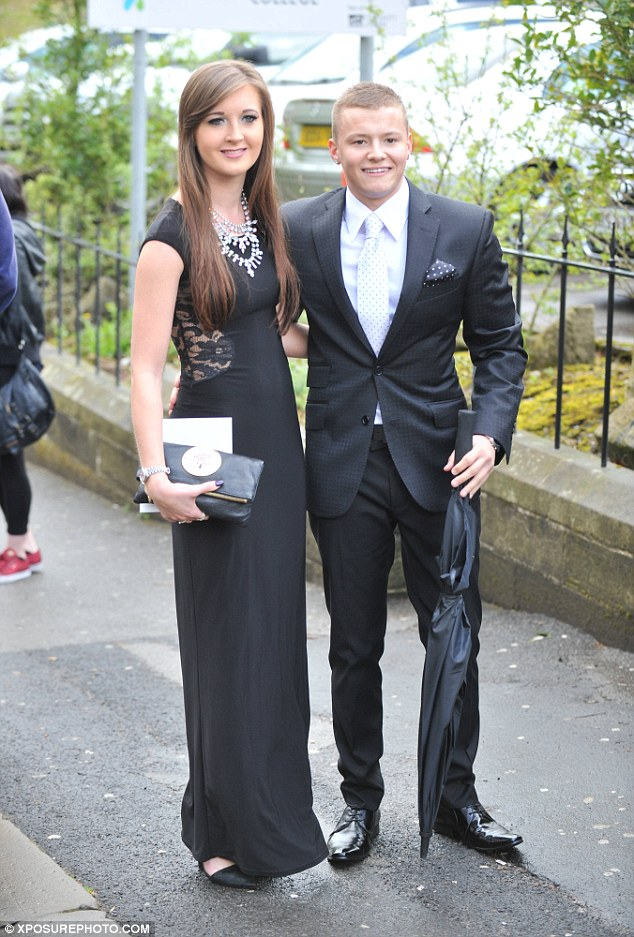 Loved up: Charlie Wernham was there with his girlfriend, suited and booted for the day
