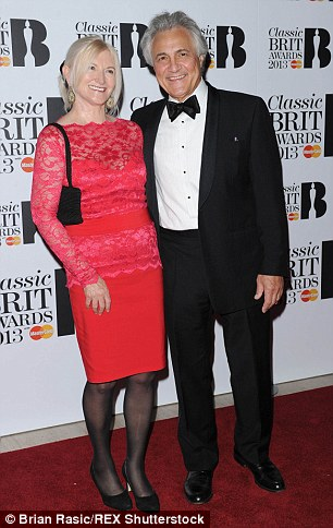 In 2009 he broke down live on air during an interview on BBC Breakfast as he gave an account of his wife's battle. They are pictured together in 2013