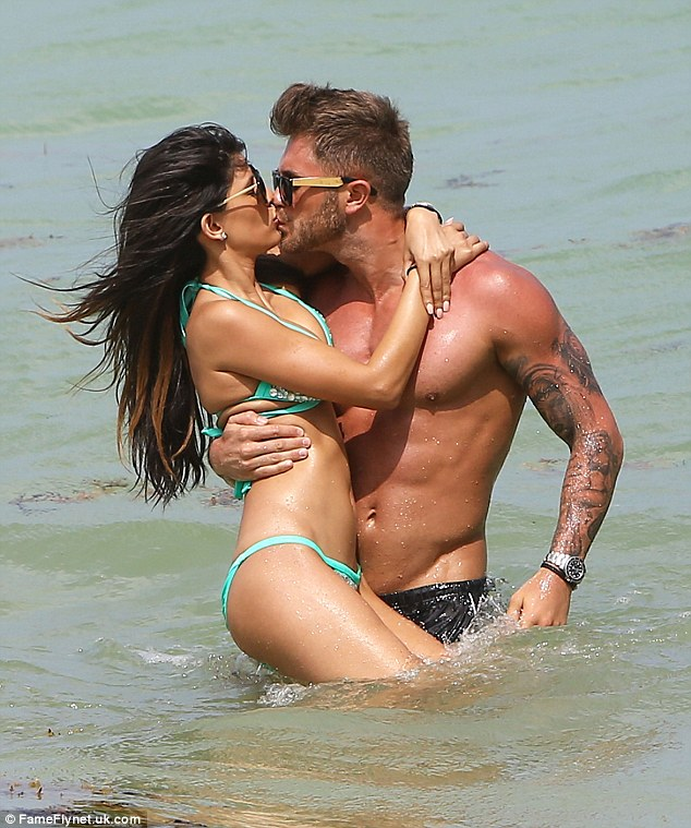 Passionate: Jasmin Walia couldn't keep her eyes off her boyfriend Ross Worswick as they hit the beach in Miami, Florida on Sunday