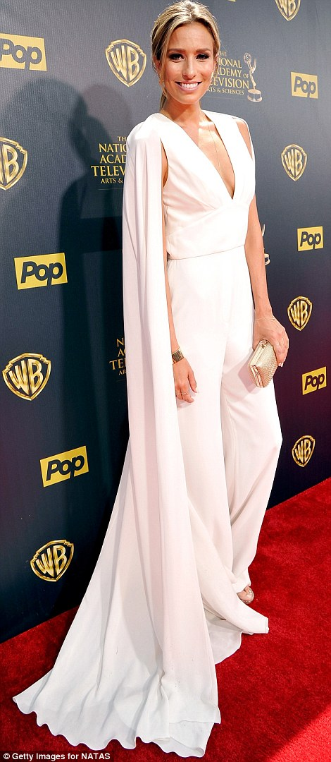 Superheroine: Australian television presenter Renee Bargh (left) donned a white V-cut jumpsuit featuring a long cape attached to it
