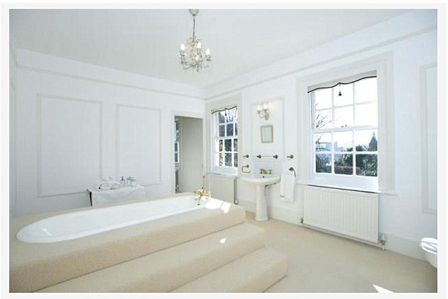 Spacious: The master bathroom - complete with steps to the tub - in the house, which was built in 1929