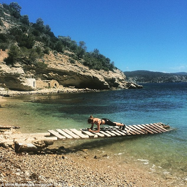 'Planking on some planks': The sun-kissed star happily shared snaps of her working out on the beautiful shores, she is on a week-long fitness camp called Pop Up Fitness Retreat