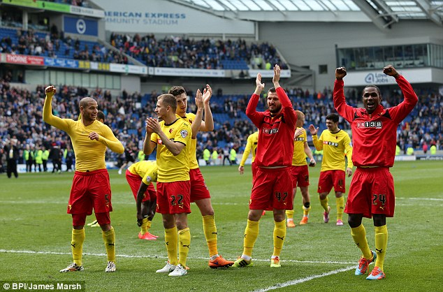 The Watford players celebrate at full-time as they secure a return to English football's top-flight