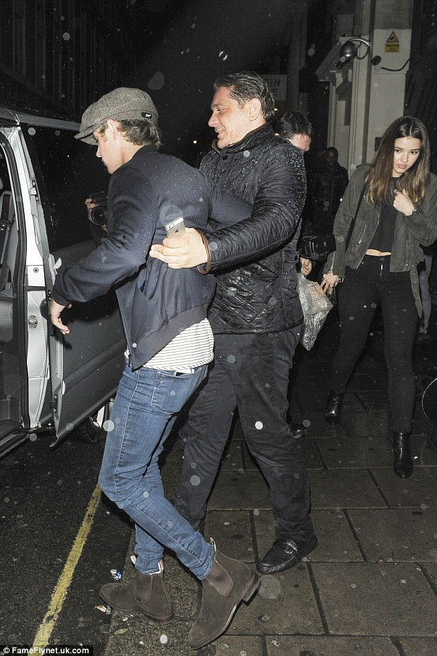 Steady on: Niall looked like he had enjoyed his night and needed to be helped to his car by a minder while Melanie followed behind