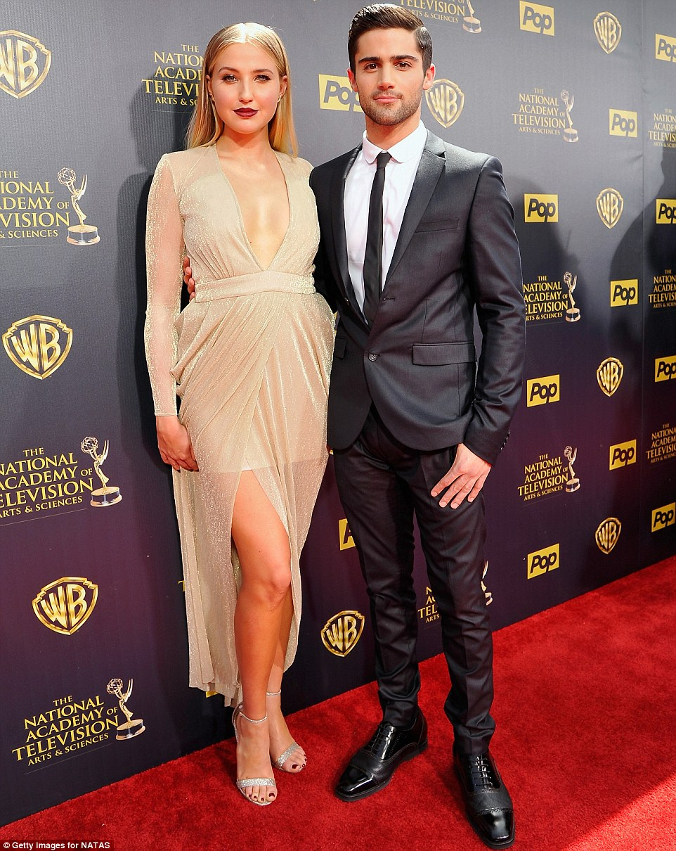 Fashionable arrival: Veronica Dunn looked good in a low-cut pale gold number as she posed alongside Max Ehrich