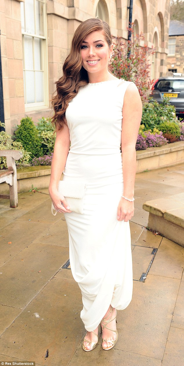 Looking good: Nikki wowed in a simple white dress set off with strappy gold heels