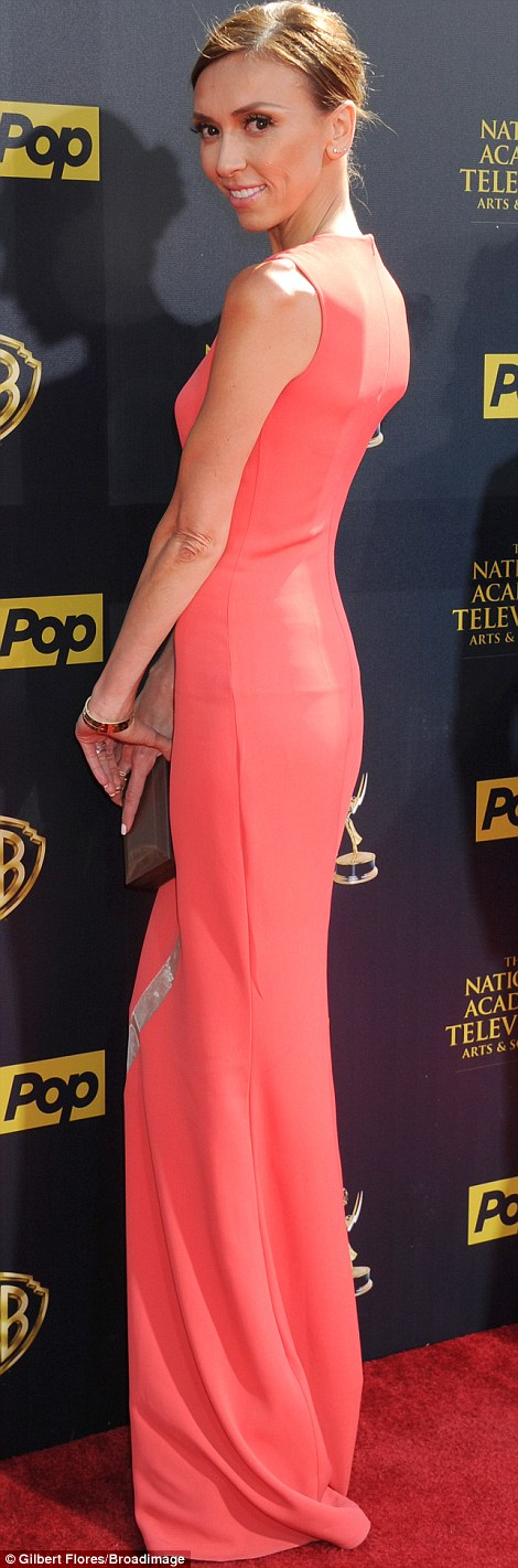 Pretty in pink: Giuliana Rancic led the fashion brigade as she hit the red carpet in a sleeveless coral gown while hitting the red carpet of the 42nd Daytime Emmy Awards in Burbanbk, California on Sunday evening
