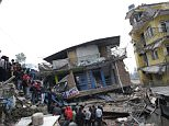 epa04720910 People survey the rubble of damaged buildings a day after a massive earthquake, in Kathmamdu, Nepal, 26 April 2015. More than 1,800 people were confirmed dead and many more were feared trapped under rubble Sunday in Nepal's worst earthquake in more than 80 years. The official death toll from the magnitude-7.9 earthquake reached 1,805, the Home Ministry said. One official said that figure could triple. Saturday's quake flattened buildings across the country and razed many historic landmarks. It was also felt in China, Bangladesh and India, where more than 40 deaths were reported. Buildings in the ancient centre of Kathmandu were destroyed, leaving mounds of timber and rubble, local television reported.  EPA/NARENDRA SHRESTHA