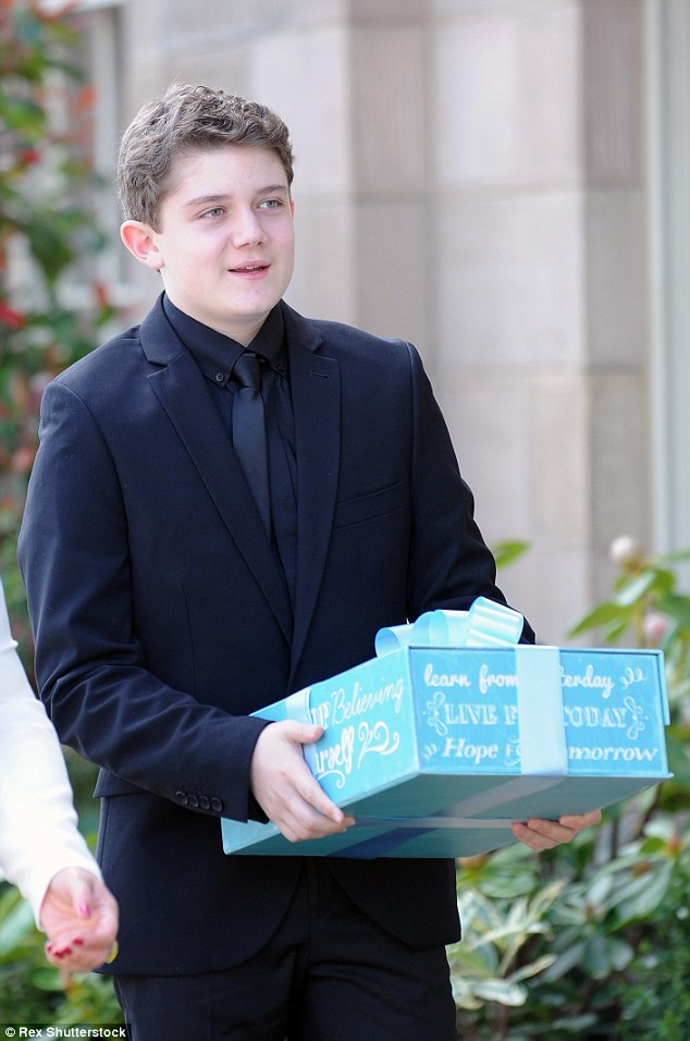 Bearing gifts: Ellis Collins, who plays Tom Cunningham, arrived with a beautifully wrapped parcel