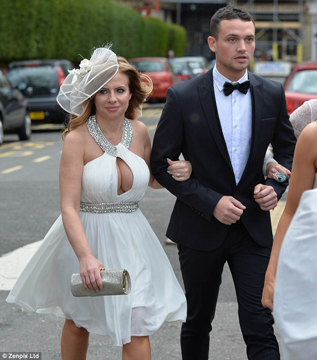 Revealing: One guest stole focus in her cleavage-enhancing white cocktail dress on the day