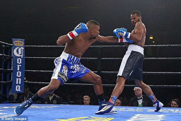 Jack (left) connects with Dirrell during their WBC world super-middleweight title fight on Friday