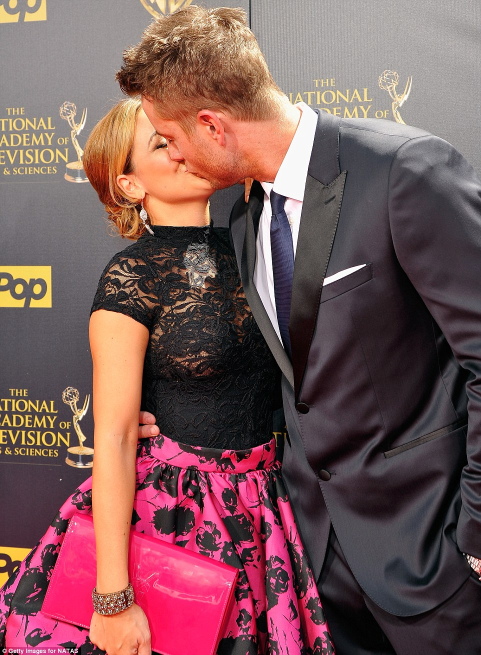 Sealed with a kiss: The 33-year-old enjoyed a smooch with fellow actor Justin Hartley