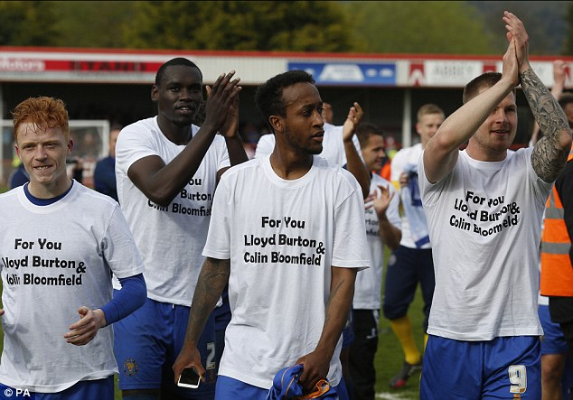 As Shrewsbury Town won promotion to League One after beating Cheltenham Town 1-0 yesterday, the Shrewsbury players revealed t-shirts paying tribute to Bloomfield and young supporter Lloyd Burton, who also passed away from cancer this week. The t-shirts read: 'For you Lloyd Burton and Chris Bloomfield' (pictured)