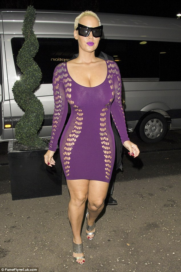Plunging purple: Amber Rose hit Wonderland in Milton Keynes on Friday night for her UK club tour