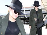 Khloe Kardashian catches a flight from LAX to Chicago days after Bruce Jenner's emotional tell-all interview with Diane Sawyer. April 27, 2015 X17online.com