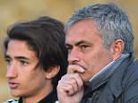 Chelsea manager Jose Mourinho looks on alongside his son Jose Junior