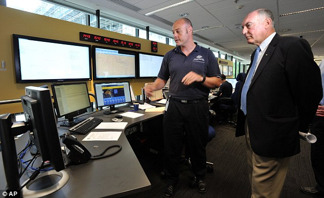 Searching: Australia's Deputy Prime Minister Warren Truss (right) and Dan Gillis, senior search and rescue officer involved in the search, look at monitors at the Australian Maritime Safety Authority's centre in Canberra