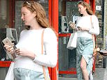 27.APRIL.2015 - LONDON - UK\n**EXCLUSIVE ALL ROUND PICTURES**\n*** STRICTLY NOT AVAILABLE FOR MAIL ONLINE AND ANY ONLINE SUBSCRIPTION DEALS UNLESS FEE AGREED PRIOR TO USAGE***\nPREGNANT MODEL LILY COLE LOOKING BUMPY IN A NICE SUMMER DRESS PICKING UP A FREE NEWSPAPER AT A TUBE STATION. \nBYLINE MUST READ : XPOSUREPHOTOS.COM\n***UK CLIENTS - PICTURES CONTAINING CHILDREN PLEASE PIXELATE FACE PRIOR TO PUBLICATION ***\nUK CLIENTS MUST CALL PRIOR TO TV OR ONLINE USAGE PLEASE TELEPHONE 0208 344 2007**