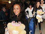 27.4.15...... Michelle Keegan and friends arrive back at Manchester Airport from her hen do in Dubai on Monday night.