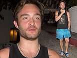 Former 'Gossip Girl' star, British actor, Ed Westwick was far from his on screen polished self as he was seen wearing a Marlon Brando singlet top, Swimming shorts, flip flops and showing off quite a few tattoo's was seen leaving the Swanky Chateau Marmont Hotel in West Hollywood, CA  Pictured: Ed Westwick Ref: SPL1011277  280415   Picture by: SPW / Splash News  Splash News and Pictures Los Angeles: 310-821-2666 New York: 212-619-2666 London: 870-934-2666 photodesk@splashnews.com