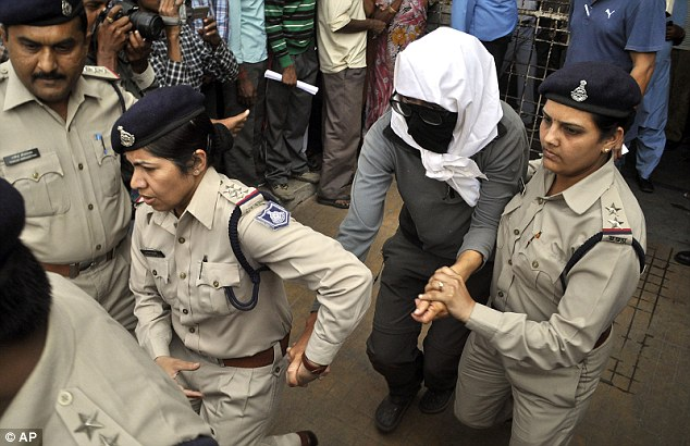 Investigation: The Swiss woman, (centre) who was allegedly attacked, is escorted by policewomen for a medical examination at a hospital in Gwalior, in the central Indian state of Madhya Pradesh