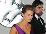 Stana Katic\n20th Annual Elton John Academy Awards Viewing Party held at West Hollywood Park, West Hollywood, California, USA.\nFebruary 26th, 2012\noscars full length dress wrap slit split walking sleeveless clutch bag black beige shoes purple \nCAP/ADM/BP\n©Byron Purvis/AdMedia/Capital Pictures\n
