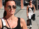 Kyle Richards wearing white dungarees and a black handbag with tassels, leaves Kyle by Alene Too on Brighton Way after a shopping spree\nFeaturing: Kyle Richards\nWhere: Los Angeles, California, United States\nWhen: 28 Apr 2015\nCredit: Winston Burris/WENN.com