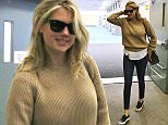 Picture Shows: Kate Upton  April 29, 2015    Model and actress Kate Upton arriving on a flight in Vancouver, Canada. Kate was returning to Vancouver from a quick trip to England. Upon her arrival she stopped to sign some autographs for fans.     Non Exclusive  UK RIGHTS ONLY    Pictures by : FameFlynet UK © 2015  Tel : +44 (0)20 3551 5049  Email : info@fameflynet.uk.com