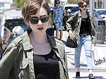 Picture Shows: Lily Collins  April 28, 2015\n \n Actress, Lily Collins, enjoys some solo shopping in Beverly Hills, California. Lily is enjoying some downtime before she has to film scenes for the romantic comedy 'How to be Single,' which also stars Dakota Johnson.\n \n Non-Exclusive\n UK RIGHTS ONLY\n \n Pictures by : FameFlynet UK © 2015\n Tel : +44 (0)20 3551 5049\n Email : info@fameflynet.uk.com