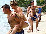 **EXCLUSIVE** Joe Calzaghe and his girlfriend Lucy on the beach while on holiday in Barbados.