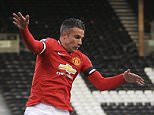 28 April 2015 - Barclays U21 Premier League - Fulham v Manchester United - Robin Van Persie of Manchester United tangles with Jonathan Buatu Mananga of Fulham - Photo: Marc Atkins / Offside.