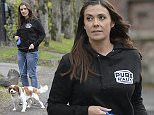 PICTURE BYLINE --- optimusimages.co.uk PICTURES SHOW --- Coronation Street star Kym Marsh seen out for a walk with her pet dog Buster, the mum of three was caught in a sudden down pour but was in good spirits. Kym was seen dressed in a black hoodie with the logo Pure Rally on & blue denim jeans. Pure Rally is a sports car Rally that Kym is taking part in next month that runs 1st May 2015 to 3rd May 2015 for more info go to www.purerally.co.uk ***Exclusive all round pictures*** DATE --- 28-04-2015 ****NOTICE, NO WEB OR TV USAGE WITHOUT PRIOR AGREEING A FEE**** ****Please Email - pictures@optimusimages.co.uk or visit  -  www.optimusimages.co.uk****