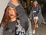 .2015 - LOS ANGELES - USA BARBADIAN SINGER RIHANNA MAKES HER WAY THROUGH LAX AIRPORT AFTER HER ARRIVAL ON A FLIGHT FROM HAWAII. THE POP DIVA IS BACK IN LOS ANGELES AFTER A MEMORABLE VACATION IN HAWAII, WHERE SHE SERVED AS A BRIDESMAID IN HER ASSISTANT/FRIENDS WEDDING.  RIHANNA WAS THE CENTER OF ATTENTION AS SHE WORE A HOODED PONCHO OVER A BLACK PUMA T-SHIRT, CUT OFF JEAN SHORTS AND A PAIR OF MATCHING PUMA SNEAKERS! BYLINE MUST READ : XPOSUREPHOTOS.COM *AVAILABLE FOR UK SALE ONLY ***UK CLIENTS - PICTURES CONTAINING CHILDREN PLEASE PIXELATE FACE PRIOR TO PUBLICATION *** *UK CLIENTS MUST CALL PRIOR TO TV OR ONLINE USAGE PLEASE TELEPHONE 0208 344 2007*