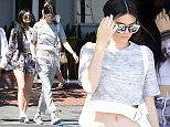 Picture Shows: Kylie Jenner, Kendall Jenner  April 28, 2015    Reality star sisters Kylie and Kendall Jenner are seen leaving Fred Segal in West Hollywood, California with a friend. 17 year old Kylie held hands with a girlfriend while leaving the trendy store.     Non Exclusive  UK RIGHTS ONLY    Pictures by : FameFlynet UK © 2015  Tel : +44 (0)20 3551 5049  Email : info@fameflynet.uk.com