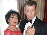LONDON, ENGLAND - APRIL 29:  Dame Shirley Bassey (L) and Pierce Brosnan attend the Lotsofcharity.com Remarkable dinner at the St Pancras Renaissance Hotel on April 29, 2015 in London, England.  (Photo by Dave Benett/Lots of Charity/Getty Images)