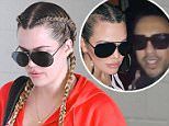 Khloe Kardashian wears her hair in braids after her workout in Beverly Hills, CA.\n\nPictured: Khloe Kardashian\nRef: SPL1011846  290415  \nPicture by: Vladimir Labissiere/Splash News\n\nSplash News and Pictures\nLos Angeles: 310-821-2666\nNew York: 212-619-2666\nLondon: 870-934-2666\nphotodesk@splashnews.com\n