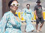 EXCLUSIVE: Lady Gaga and Taylor Kinney stroll across the Pacific Coast Highway ahead of her two concert dates at the Hollywood Bowl with Tony Bennett.  Gaga wore a turquoise kaftan and white sunglasses.  Taylor went barefoot for the short walk to the beach in Malibu. The couple were joined by Taylor's mom Pamela Heisler.    Pictured: Lady Gaga,Taylor Kinney,Pamela Heisler Ref: SPL1011632  290415   EXCLUSIVE Picture by: Splash News  Splash News and Pictures Los Angeles: 310-821-2666 New York: 212-619-2666 London: 870-934-2666 photodesk@splashnews.com