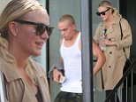 Picture Shows: Evan Ross, Ashlee Simpson  May 01, 2015\n \n Pregnant singer Ashlee Simpson and her husband Evan Ross go for a workout at the Tracy Anderson gym in Studio City, California. Ashlee kept her bump under wraps in a beige trench coat.\n \n Non Exclusive\n UK RIGHTS ONLY\n \n Pictures by : FameFlynet UK © 2015\n Tel : +44 (0)20 3551 5049\n Email : info@fameflynet.uk.com