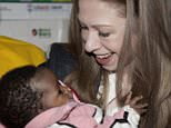 Chelsea Clinton holds a baby, Friday, May 1, 2015 when she visits Mbagathi District Hospital in Nairobi, Kenya, where she saw the work of the Clinton Health Access Initiative (CHAI) in educating families about use of Zinc and Oral Rehydration Salts (ORS) in treating diarrhea. Former President Bill Clinton and his daughter, Chelsea, are in the East African nation as part of a wider tour of projects run by the family's Clinton Foundation. (AP Photo/Sayyid Azim)