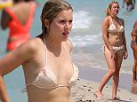 **EXCLUSIVE** 'Made In Chelsea' star Caggie Dunlop at the beach in Miami with her boyfriend Scott Sullivan. This is the first time Caggie has been photographed in a bikini. She was seen wearing a nude colored ruffled bikini. The couple frolicked in the water before returning to their beachfront hotel.
