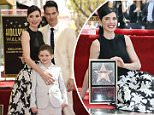 Julianna Margulies, left, and son Kieran Lieberthal and husband Keith Lieberthal, attend a ceremony where she is honored with a star on the Hollywood Walk of Fame on Hollywood Boulevard on Friday, May 1, 2015, in Los Angeles. (Photo by Chris Pizzello/Invision/AP)