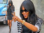 Naomi Campbell is all smiles while wearing a denim dress and carrying her Burberry handbag, after having lunch with a friend at Kappo Masa sushi restaurant on the Upper East Side in New York City on April 30, 2015.\n\nPictured: Naomi Campbell\nRef: SPL1013148  300415  \nPicture by: Felipe Ramales / Splash News\n\nSplash News and Pictures\nLos Angeles: 310-821-2666\nNew York: 212-619-2666\nLondon: 870-934-2666\nphotodesk@splashnews.com\n