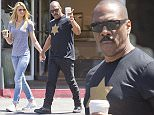 EXCLUSIVE: Eddie Murphy and girlfriend Paige Butcher stop for Starbucks coffee in Beverly Hills, California.  Pictured: Eddie Murphy, Paige Butcher Ref: SPL994642  300415   EXCLUSIVE Picture by: Deano /TC/ Splash News  Splash News and Pictures Los Angeles: 310-821-2666 New York: 212-619-2666 London: 870-934-2666 photodesk@splashnews.com