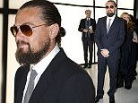 Leonardo DiCaprio arrives for a Giorgio Armani exclusive fashion show in Milan, Italy, Thursday, April 30, 2015. The Milan Expo 2015 world's fair has some heady ambitions: devise a plan to feed the planet, boost Italy's economy and raise Milan's profile. Giorgio Armani has invited VIP guests to an exclusive fashion show on the eve of Expo and opens a museum recounting his 40-year history called Silos, which will remain a fixture. (AP Photo/Luca Bruno)
