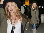 Kate Hudson touches down at JFK airport after arriving from Los Angeles tonight in NYC \n\nPictured: Kate Hudson\nRef: SPL1014439  010515  \nPicture by: Turgeon-Abbot / Splash News\n\nSplash News and Pictures\nLos Angeles: 310-821-2666\nNew York: 212-619-2666\nLondon: 870-934-2666\nphotodesk@splashnews.com\n