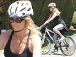 UK CLIENTS MUST CREDIT: AKM-GSI ONLY\nEXCLUSIVE: Goldie Hawn takes advantage of a sunny afternoon and goes for a solo bike ride in Los Angeles.\n\nPictured: Goldie Hawn\nRef: SPL1014365  010515   EXCLUSIVE\nPicture by: AKM-GSI / Splash News\n\n